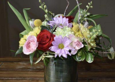 bright flower variety arrangement in vase