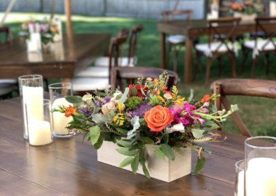 Bright floral centerpiece on farmhouse tables