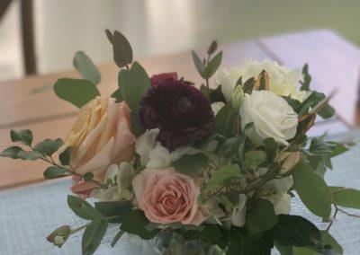 roses in an arrangement in glass vase