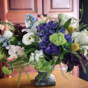 flower arrangement in pedestal urn
