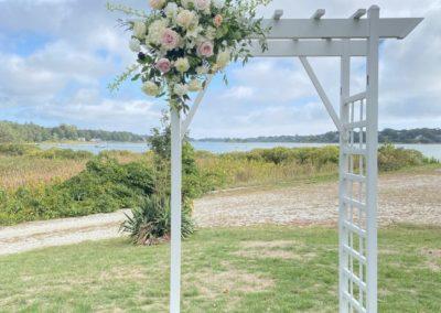 pastel flower arrangement on trellis arbor pergola