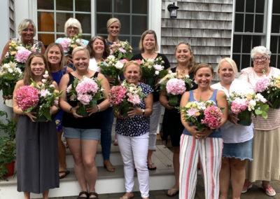 group of people after flower arrangement class